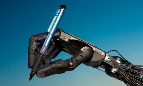 University of Warwick Shadow Robot Hand holding a pen.